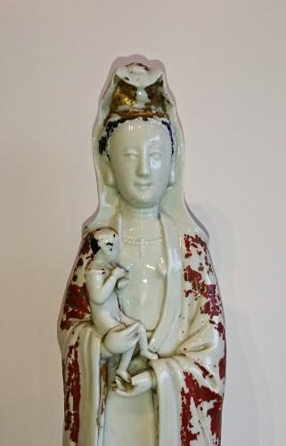 Porcelain & Faience  - A Chinese Dehua Blanc de Chine Guan Yin holding a child, circa 1700