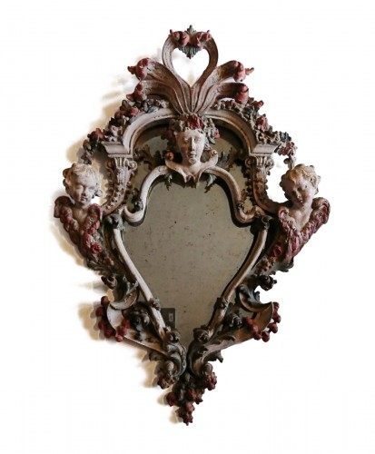 A small Genoese rococo carved and painted wood mirror, circa 1740