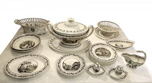 A composite set of 229 Creil faience fine pieces with black engraved decor