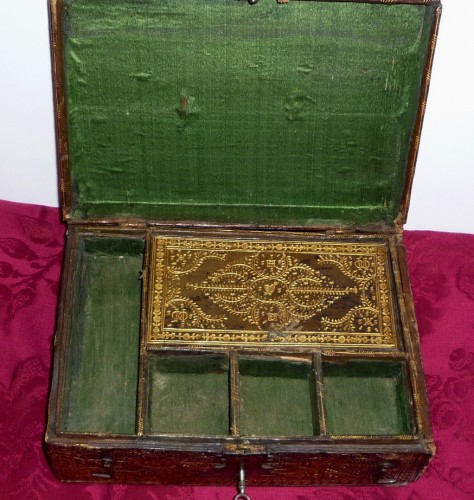 A Louis XIII Parisian leather casket with petits fers decoration -