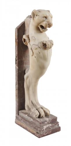 A neoclassical marble sculpture of a lion head protome