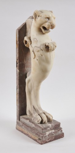 A neoclassical marble sculpture of a lion head protome -