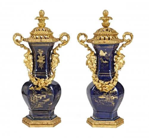 A pair of powdered blue vases with Piedmontese gilt wood mounts c. 1780
