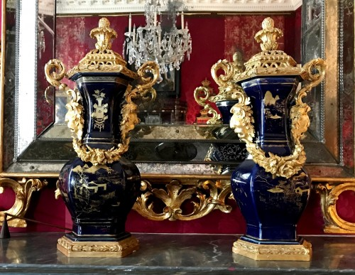 - A pair of powdered blue vases with Piedmontese gilt wood mounts c. 1780