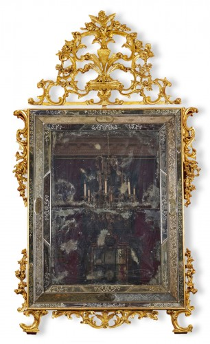A large Venetian baroque gilt wood mirror circa 1720