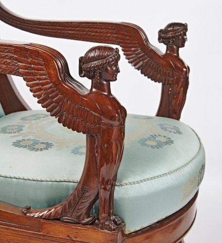 A pair of French Empire mahogany armchairs with winged sphinxes -