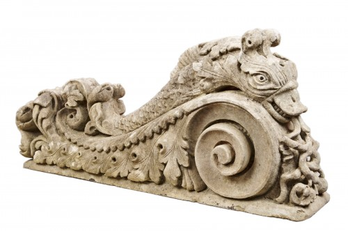 A pair of Sicilian stone baroque carvings of dolphins 18th century