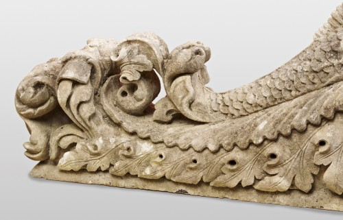 A pair of Sicilian stone baroque carvings of dolphins 18th century -