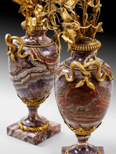 A pair of French bluejohn vases mounted as candelabra circa 1830 -