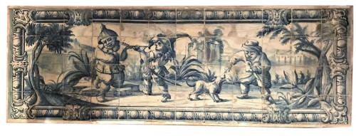 A Portuguese azulejo panel with children or dwarfs 18th century