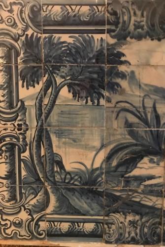A Portuguese azulejo panel with children or dwarfs 18th century -