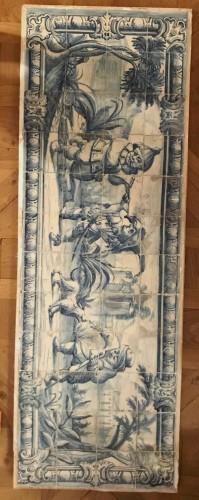 - A Portuguese azulejo panel with children or dwarfs 18th century