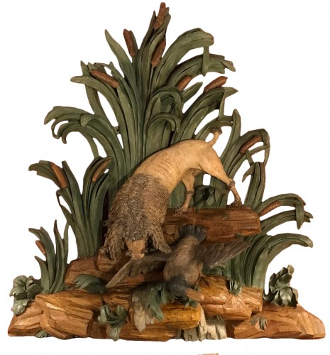 A French carved wood group of a dog attacking a duck circa 1750