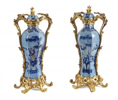 A pair of Chinese Qianlong period vases mounted in ormolu