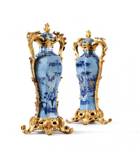 A pair of Chinese Qianlong period vases mounted in ormolu -