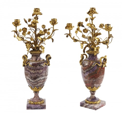 A pair of French bluejohn vases mounted as candelabra circa 1830