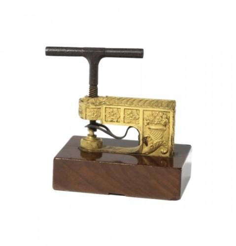 A French Empire ormolu and mahogany seal press