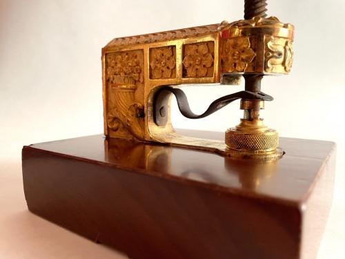 Curiosities  - A French Empire ormolu and mahogany seal press
