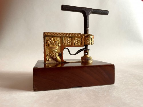 A French Empire ormolu and mahogany seal press -