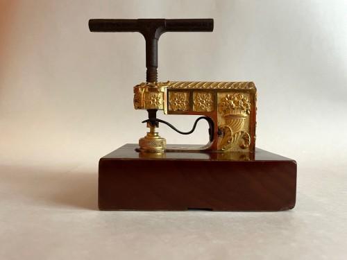 - A French Empire ormolu and mahogany seal press