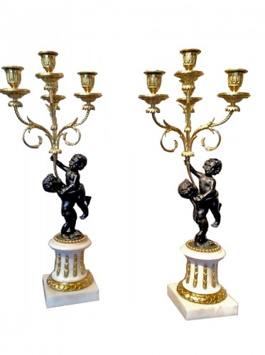A Pair of early 19th century candelabra