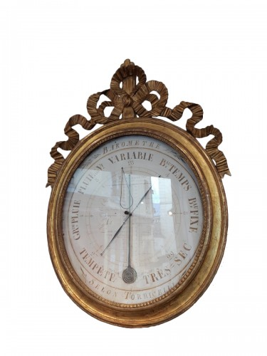 Barometer in carved and gilded wood of Louis XVI period