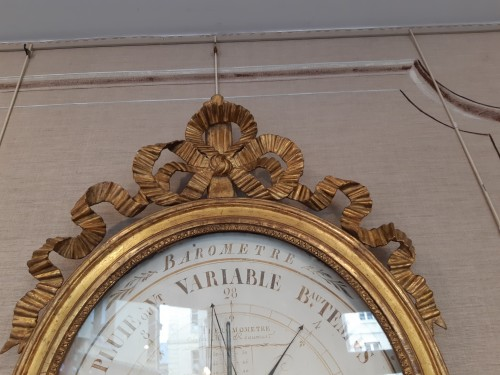 Barometer in carved and gilded wood of Louis XVI period -