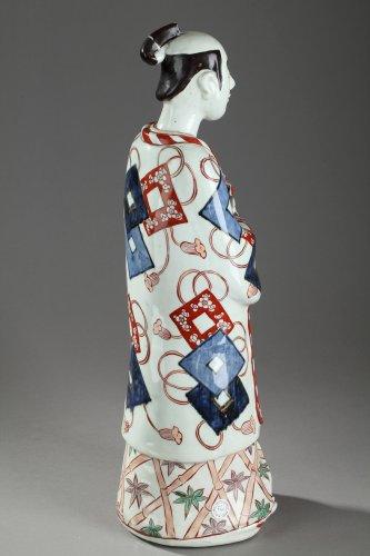 Japan, Arita -  Large figure of a man holding a fan. 17th century - Porcelain & Faience Style