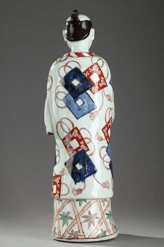 Porcelain & Faience  - Japan, Arita -  Large figure of a man holding a fan. 17th century