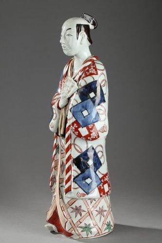 Japan, Arita -  Large figure of a man holding a fan. 17th century -