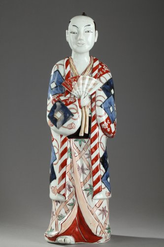 17th century - Japan, Arita -  Large figure of a man holding a fan. 17th century