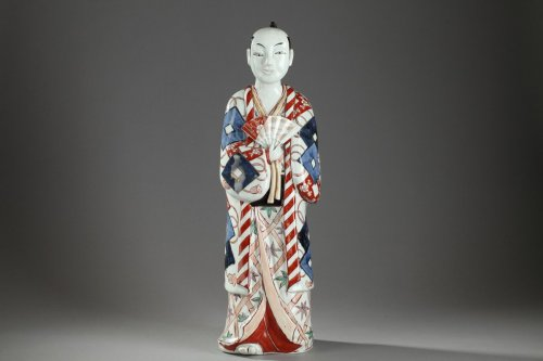 Japan, Arita -  Large figure of a man holding a fan. 17th century -