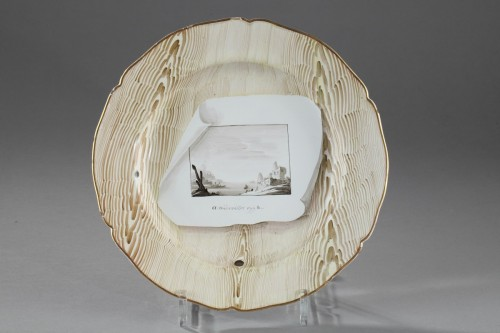 Niderviller Faience plate decorated in trompe l'oeil. Circa 1774 -