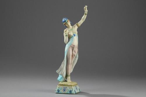 - A Lachenal figure of a woman dancing. Circa 1890 - 1900