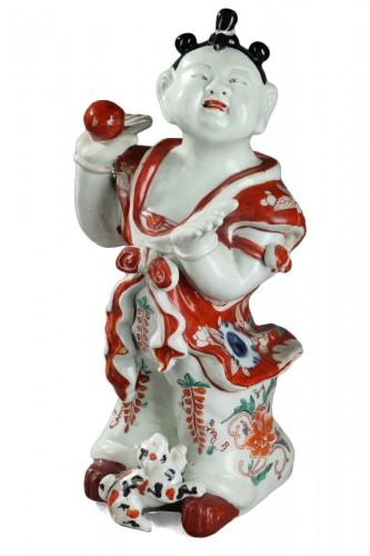 JAPAN. ARITA : Early 18th century figure of a boy.