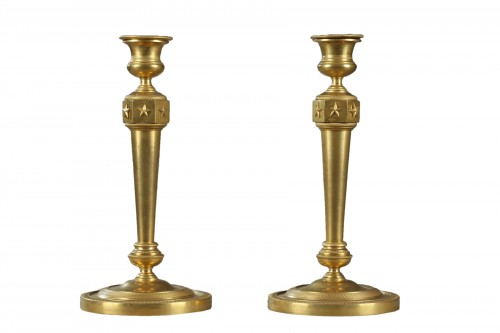 Gilded bronze pair of candelabras . Early 19th century