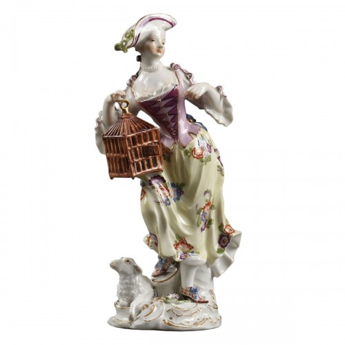 Meissen : Figure of a woman holding an open cage 18th century