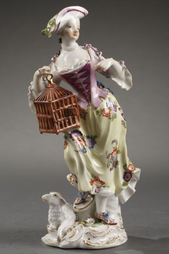 Porcelain & Faience  - Meissen : Figure of a woman holding an open cage 18th century