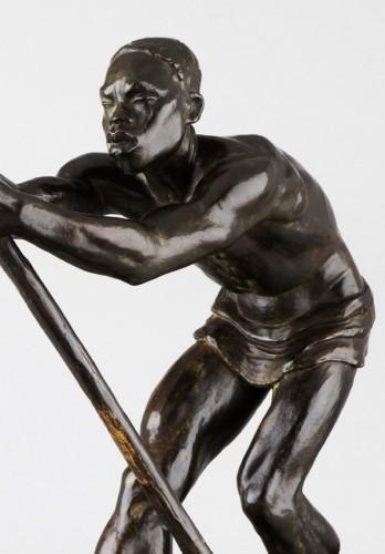 African Man on a dugout Canoe - Arthur DUPAGNE (1895-1961) -
