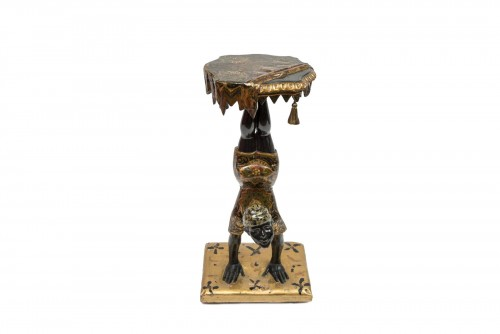 A Polychrome Venitian Stand representing a Nubian Acrobat -