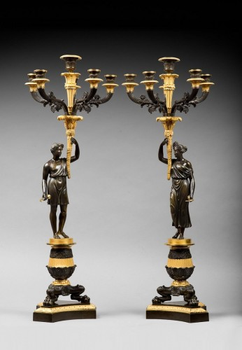 19th century - An empire patinated and gilded bronze pair of candelabras