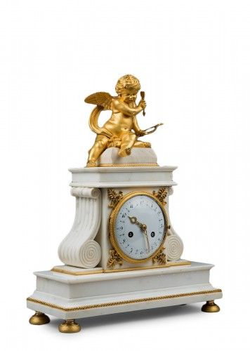 A Directoire ormolu and white marble clock