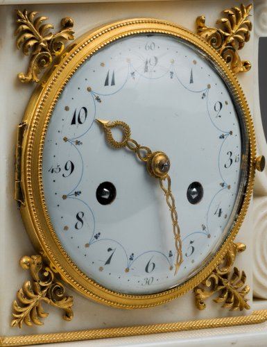 Clocks  - A Directoire ormolu and white marble clock