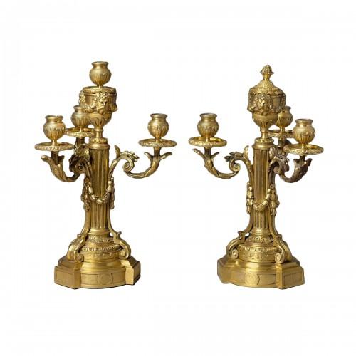 A Louis XVI pair of gilded bronze candelabras
