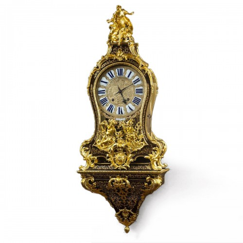 A French brass-inlaid brown tortoiseshell Boulle marquetry cartel clock