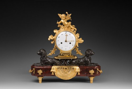 A Louis XVI ormolu, patinated bronze and rouge griotte marble mantel clock - Louis XVI