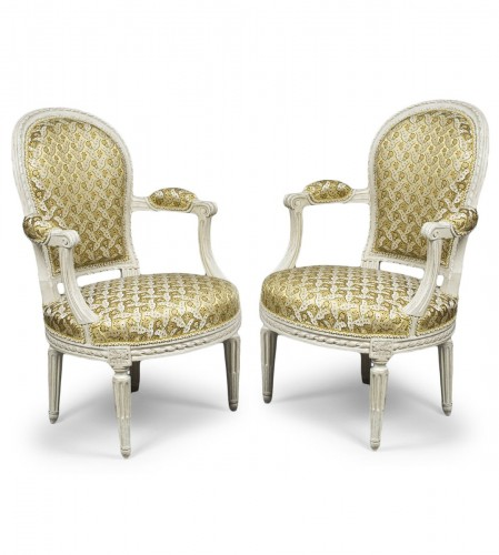 A pair of Louis XVI white-painted fauteuils en cabriolet