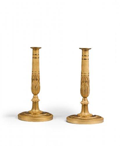 A pair of ormolu Empire Candlesticks