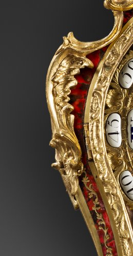 A Louis XV ormolu-mounted tortoise-shell cartel clock and bracket -