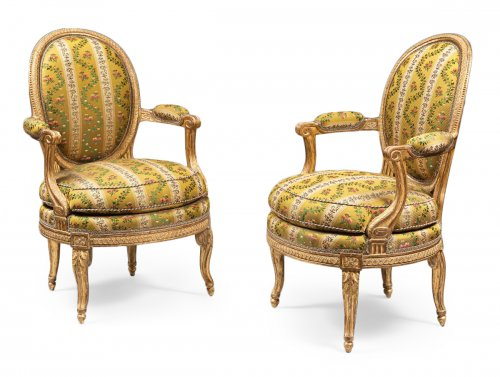 A rare pair of Louis XVI gilt wood armchairs